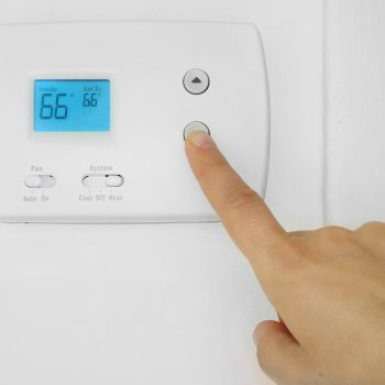 adjusting a wall mounted thermostat temperature